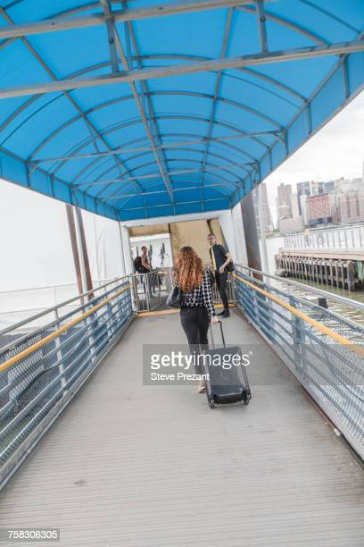 Rear view of businesswoman arriving at ferry terminal