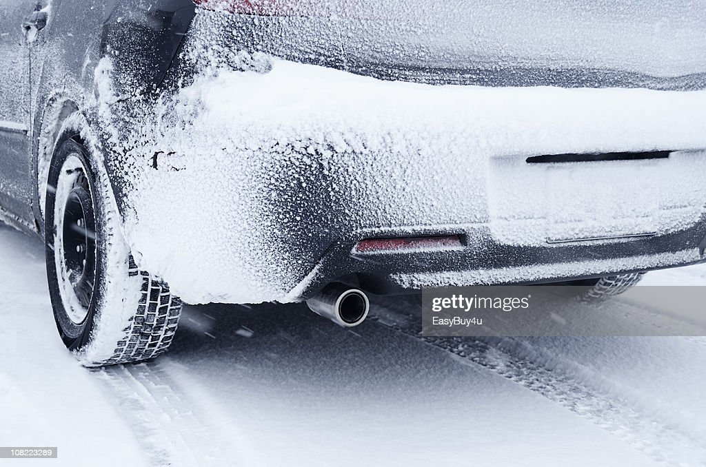Rear View of Car Covered in Snow