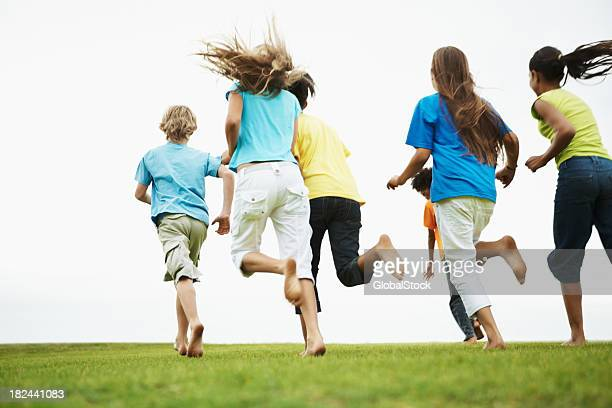 Rear view of children running in a park