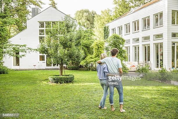 Rear view of couple strolling in garden