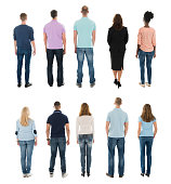 Rear View Of Creative People Standing In Row Against White Background