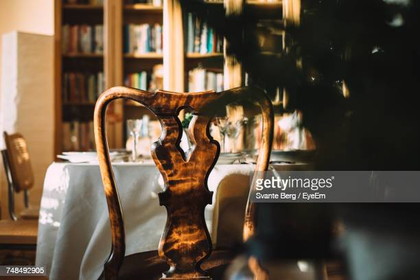 Rear View Of Empty Chair By Table At Home