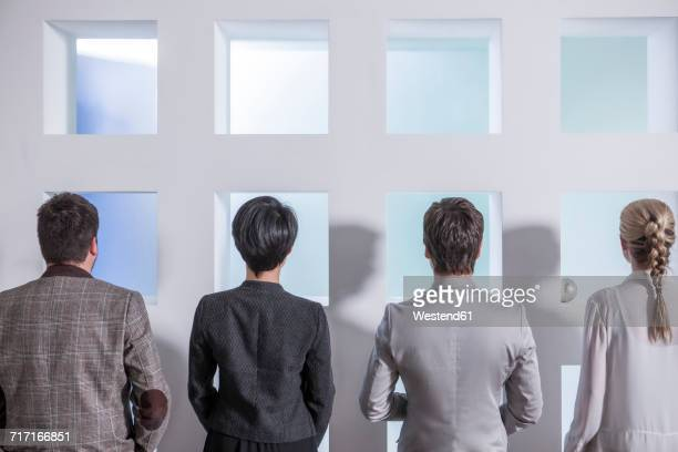 Rear view of four businesspeople