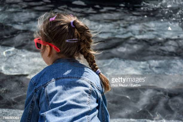 Rear View Of Girl Against Sea