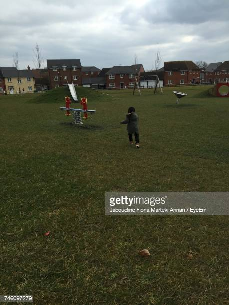 Rear View Of Girl Running In Park