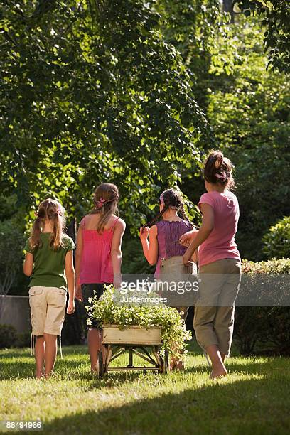 Rear view of girls in garden