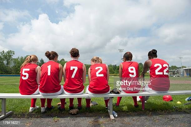 Rear View of Girls' Softball Team on Bench