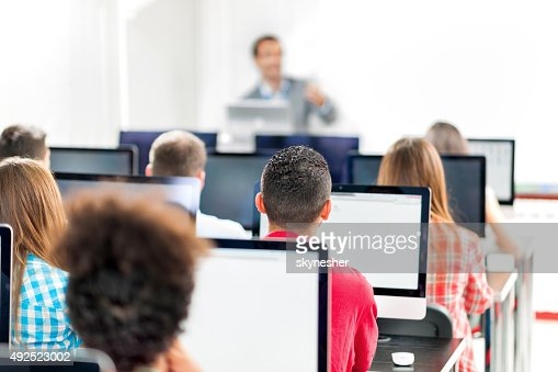 Rear view of group of people in a computer lab.