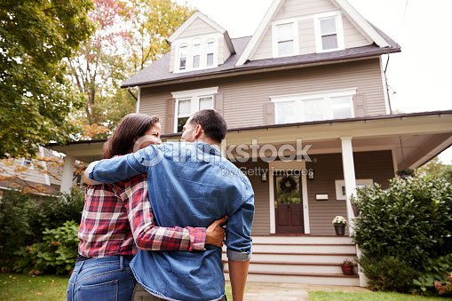 Rear View Of Loving Couple Walking Towards House : Stock Photo