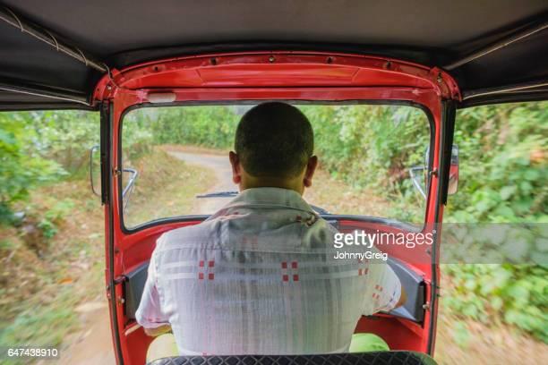Rear view of man driving rickshaw, Sri Lanka