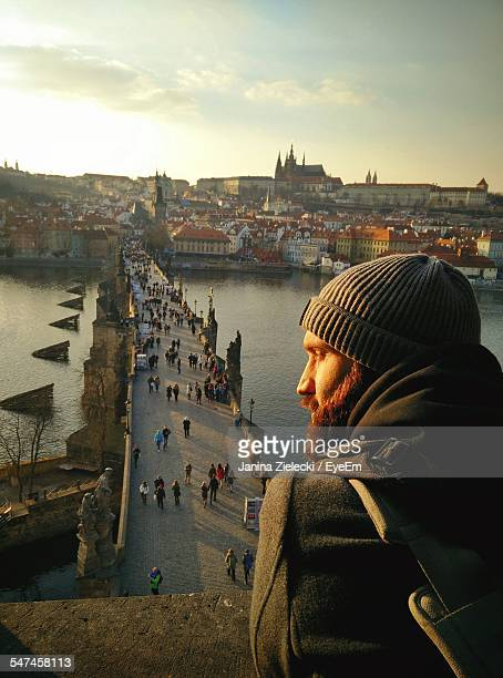Rear View Of Man In Front Of Charles Bridge Over River