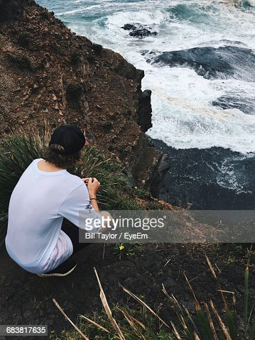 Rear View Of Man Looking At Sea From Cliff