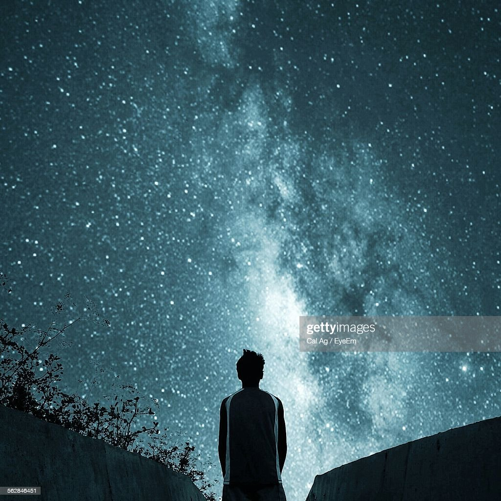 Rear View Of Man Looking At Star Field In Sky At Night : Stock Photo