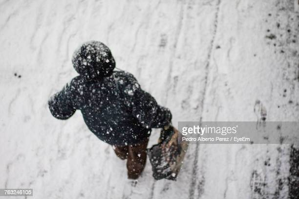 Rear View Of Man On Snow