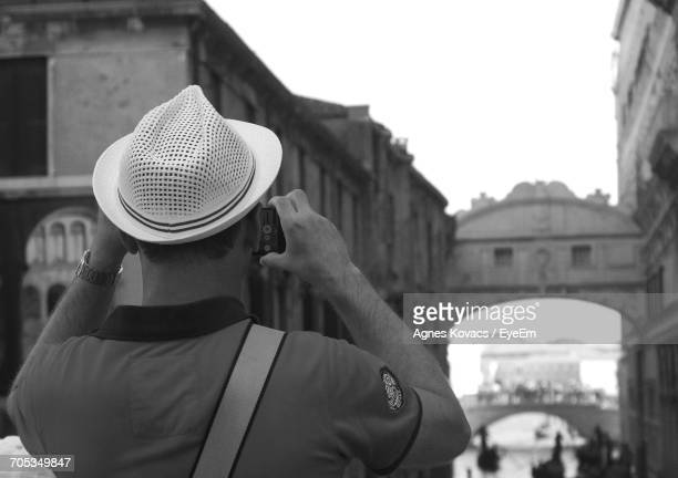 Rear View Of Man Photographing Bridge Of Sighs