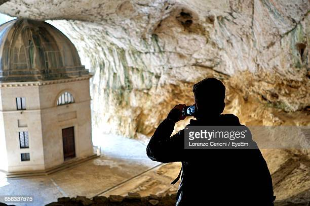Rear View Of Man Photographing Tempietto Valadier In Cave