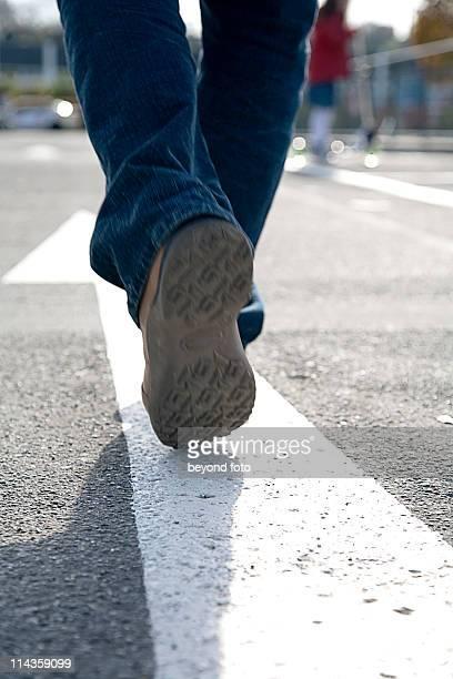 rear view of man walking in the street