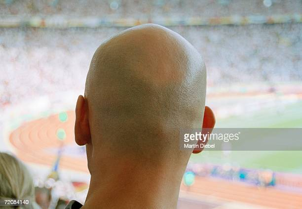 Rear view of man watching soccer game