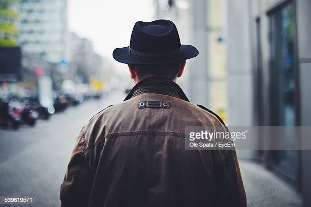 Rear View Of Man Wearing Hat And Jacket