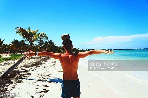 Rear View Of Man With Coconut On Head