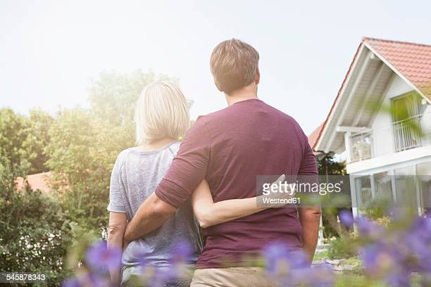 Rear view of mature couple in garden