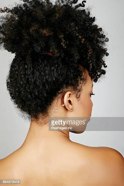 Rear view of mixed race woman looking over shoulder