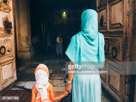 Rear View Of Mother With Child Entering Church Of Holy Sepulchre