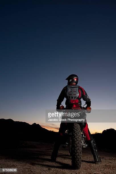 Rear View of Motocross Rider in Desert