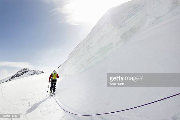 Rear view of mountaineer ski touring on snow-covered mountain, Saas Fee, Switzerland