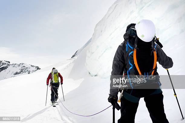 Rear view of mountaineers ski touring on snow-covered mountain, Saas Fee, Switzerland