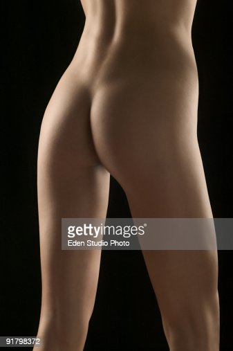 Rear view of naked woman : Stock Photo