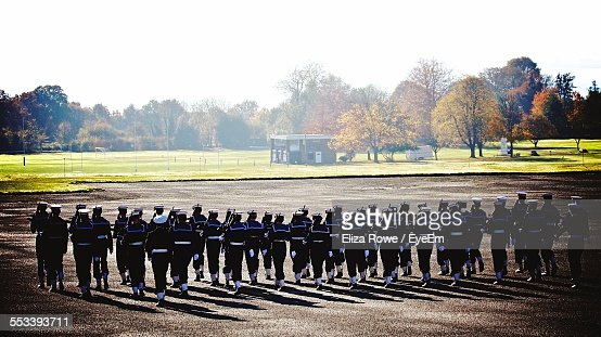 Rear View Of Navy Cadets Marching