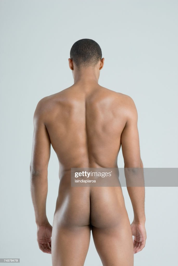 Rear view of nude African man : Stock Photo