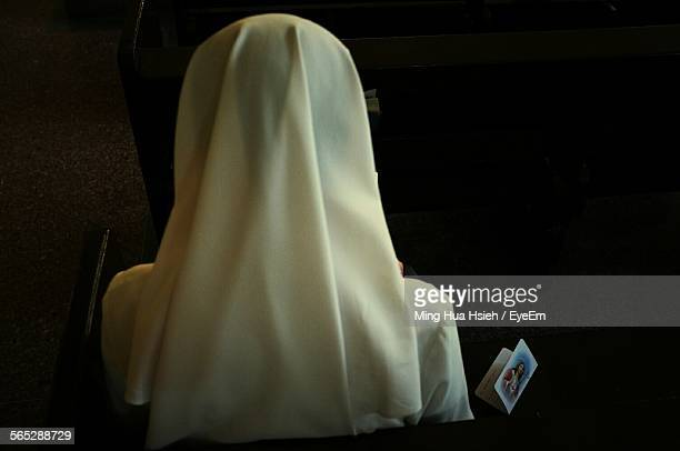 Rear View Of Nun In Church