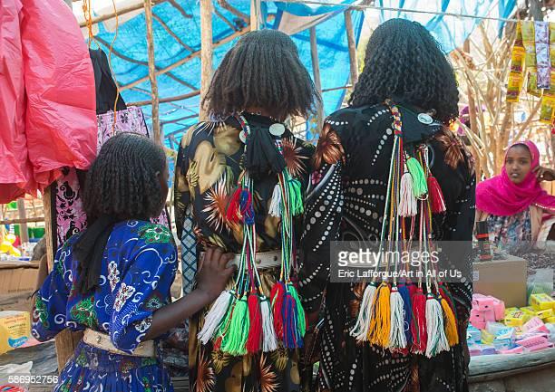 Rear view of oromo girls with pompoms to show they are singles oromo sambate Ethiopia on February 21 2016 in Sambate Ethiopia