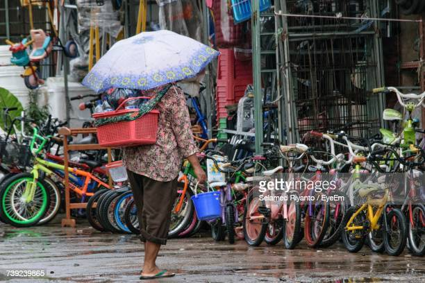 Rear View Of Person With Umbrella