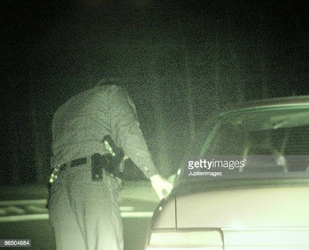 Rear view of police officer on a traffic stop