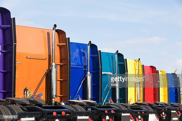 Rear view of row of tractor trailer cabs