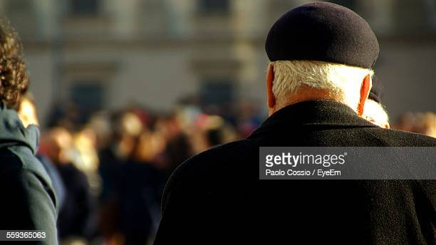 Rear View Of Senior Man In Flat Cap