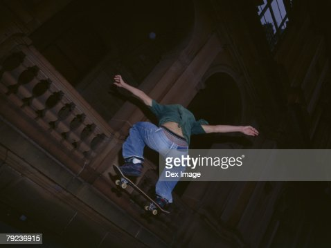 Rear view of skateboarder : Stock Photo