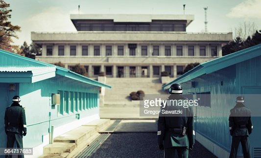 Rear view of soldiers standing at Korean Demilitarized Zone, South Korea