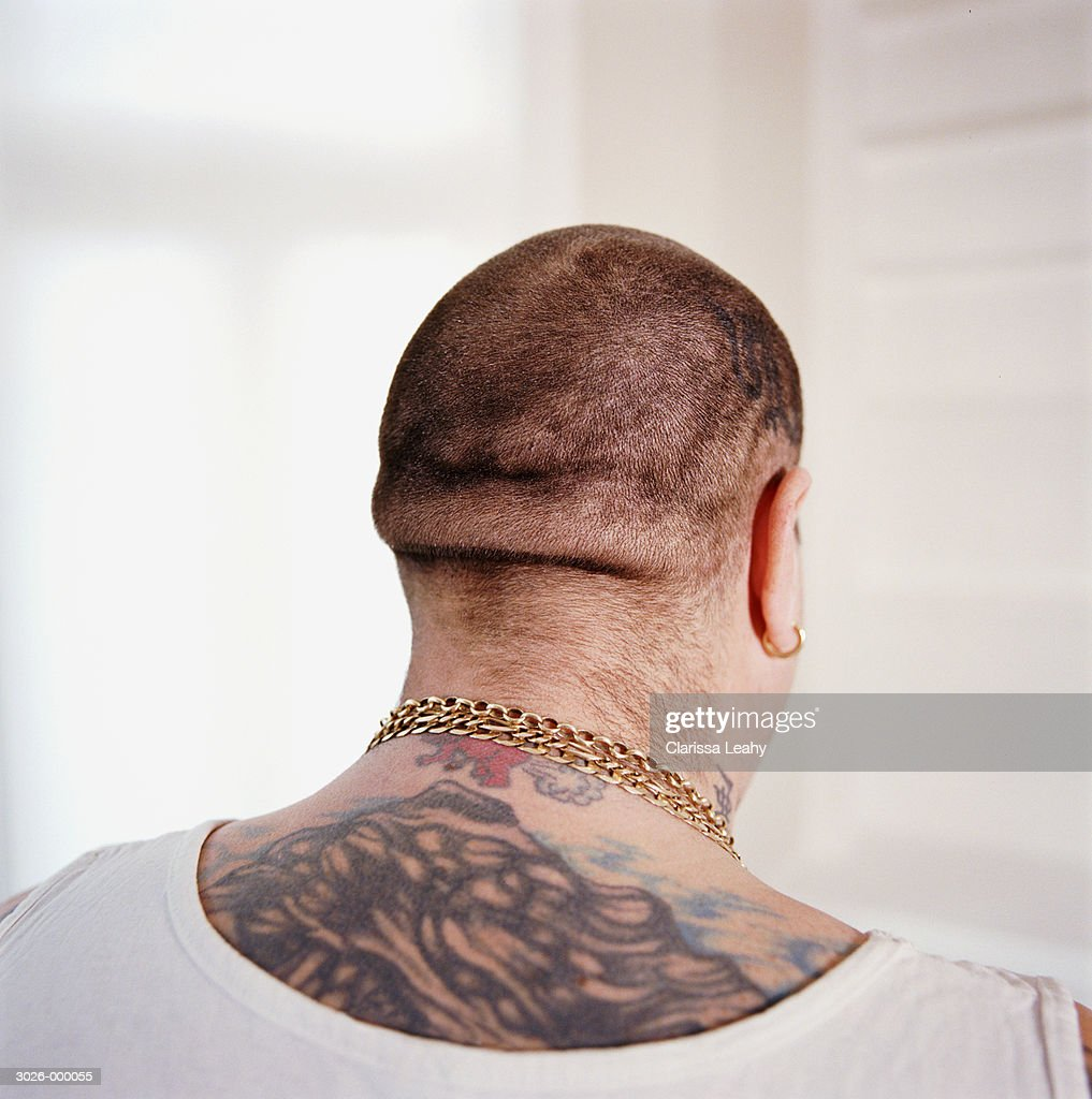 Rear View of Tattooed Man : Stock Photo