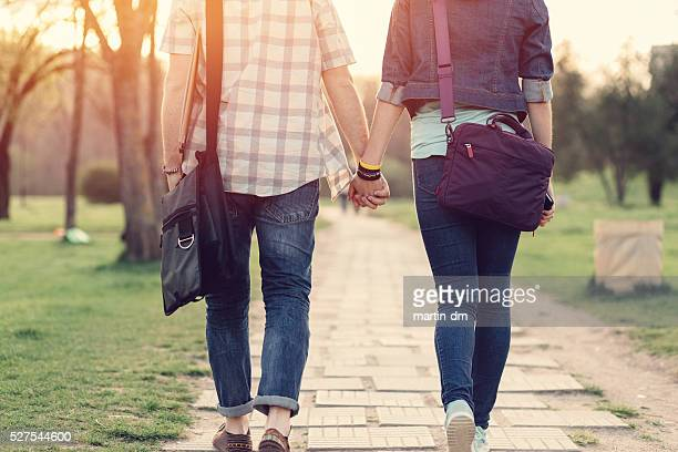 Rear view of teenage couple in the park