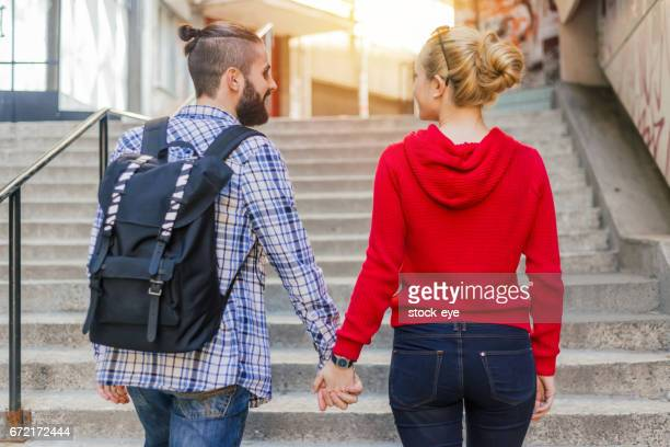 Rear view of teenage couple on the staircase