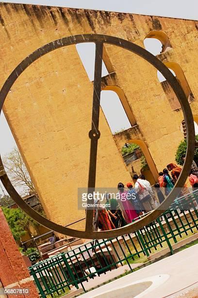 Rear view of tourists looking at a monument, Jantar Mantar, Jaipur, Rajasthan, India