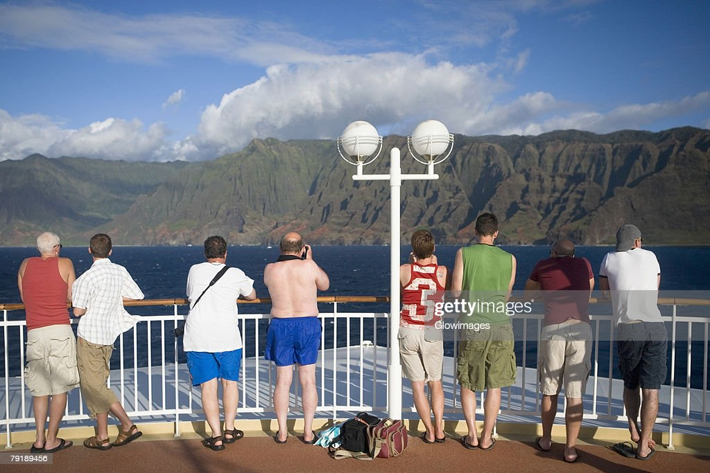 Rear view of tourists standing at observation point looking at a view, Na Pali Coast State Park, Kauai, Hawaii Islands, USA : Stock Photo