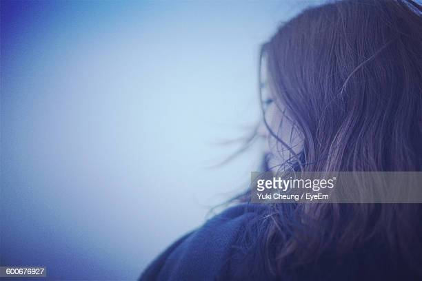 Rear View Of Woman Against Sky During Foggy Weather