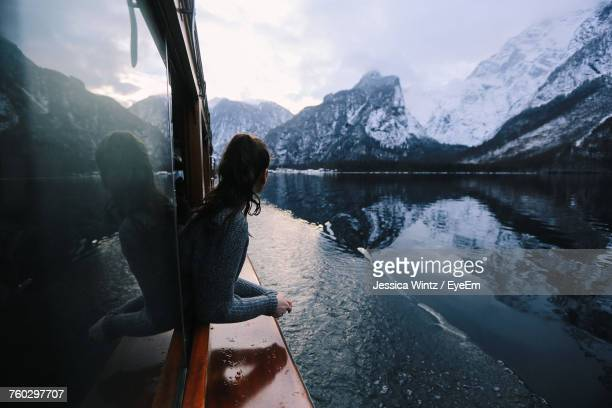 Rear View Of Woman By Lake Against Mountains