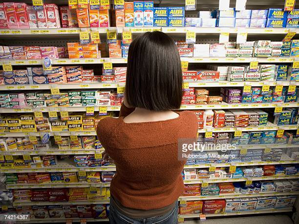 Rear view of woman in medicine aisle