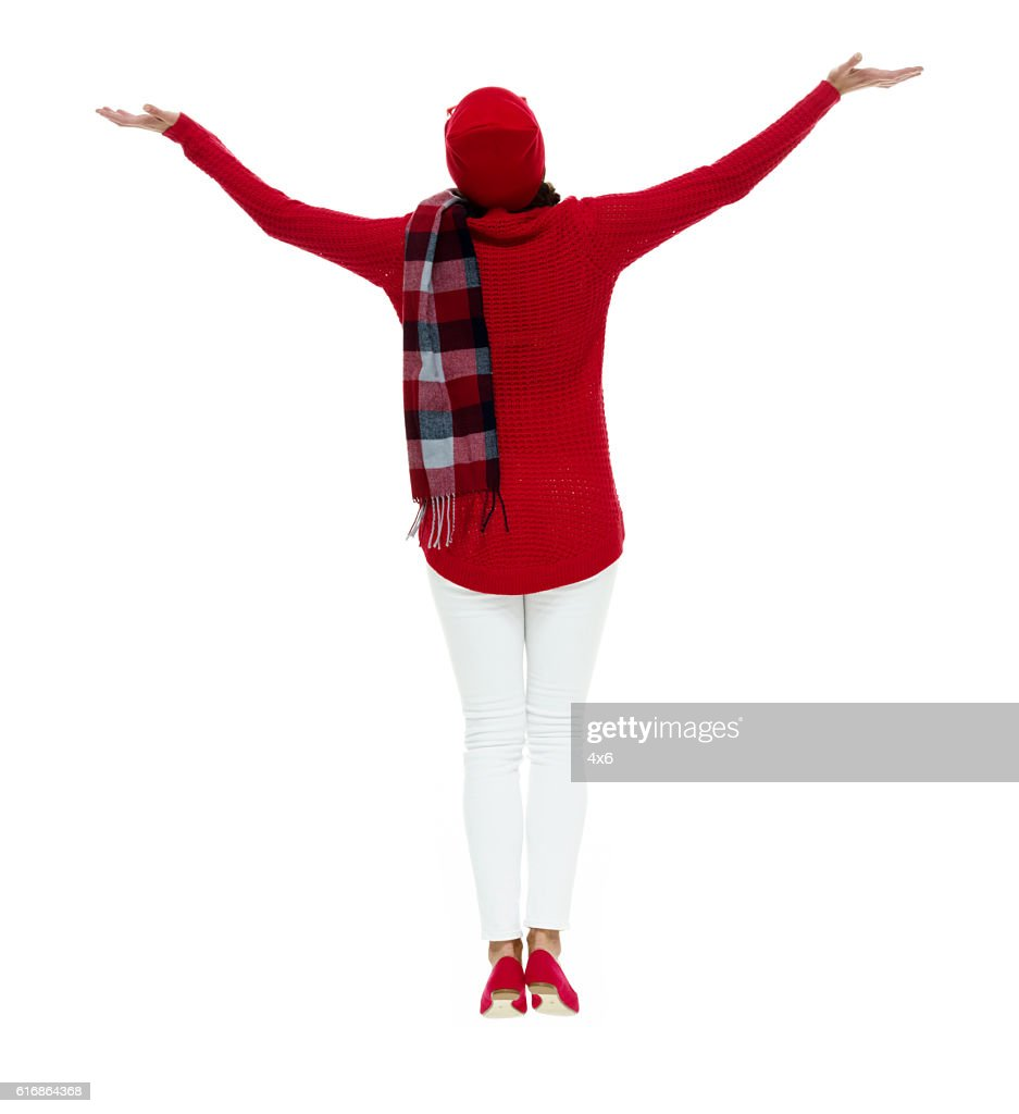Rear view of woman jumping : Stock Photo